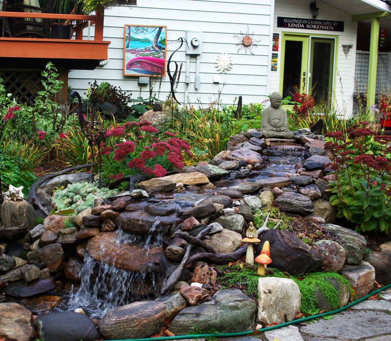 Fieldstone walkway past waterfall garden.
